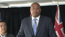 Michael Coteau speaks with reporters in this file photo.