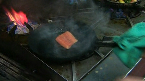 Searing a piece of fish for a Winterlicious meal.