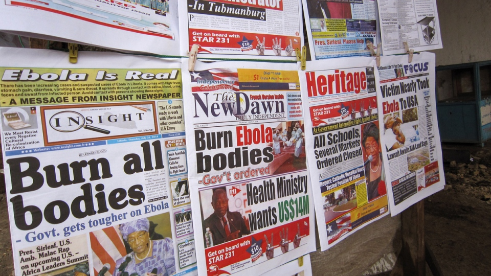 A close up of newspaper front pages focusing on the Ebola outbreak, including a newspaper, left, reading 'Burn all bodies' in the city of Monrovia, Liberia, Thursday, July 31, 2014. (AP / Jonathan Paye-Layleh)