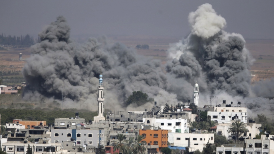 Smoke rises from an Israeli strike in Gaza City