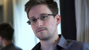 Seen in this 2013 file photo, Edward Snowden, who has confounded U.S. officials since his abrupt departure from the country two years ago, has found a new megaphone in Twitter. (AP / The Guardian)