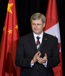 Prime Minister Stephen Harper applauds during an event recognizing 40 years of diplomatic relations with China, in Ottawa, Wednesday, Oct. 13, 2010. (Adrian Wyld / THE CANADIAN PRESS)