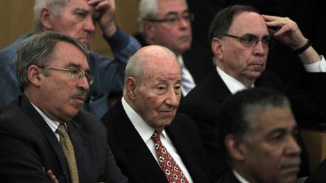 "Detroit International Bridge Company owner Manuel ""Matty"" Moroun, center, sits in court in Detroit, Jan. 12, 2012. (AP / Carlos Osorio)"