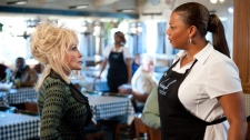 Dolly Parton, left, and Queen Latifah in a scene from Warner Bros.' 'Joyful Noise.'