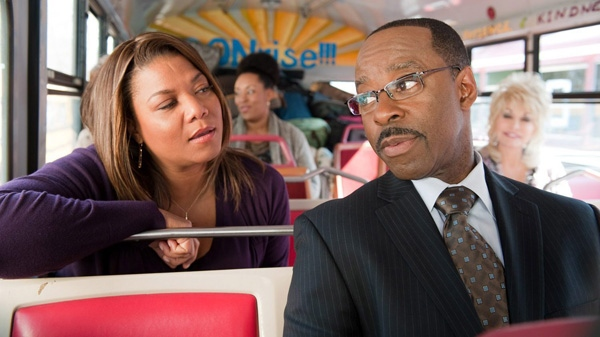 Queen Latifah, left, and Courtney B. Vance in a scene from Warner Bros.' 'Joyful Noise.'