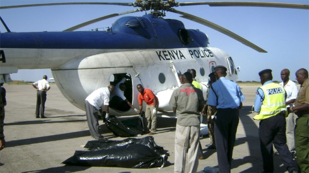 Kenyan police load the remains of fellow officers killed during an al-Shabab raid on a police station in northern Kenya, onto a helicopter at the airstrip in Garissa, Kenya Thursday, Jan. 12, 2012. (AP)