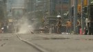 Workers tend to the LRT tracks along 7 Ave. S.W. on Saturday afternoon
