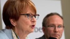 Lucienne Robillard, left, speaks at a news confere
