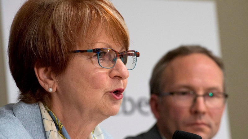 Lucienne Robillard, left, speaks at a news conference announcing her nomination as the head of a commission that will study provincial programs, Wednesday, June 11, 2014 in Quebec City. Quebec Treasury Board President Martin Coiteux looks on. THE CANADIAN PRESS/Jacques Boissinot