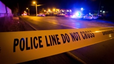 Police tape is shown in a file photo. (Darryl Dyck / THE CANADIAN PRESS)