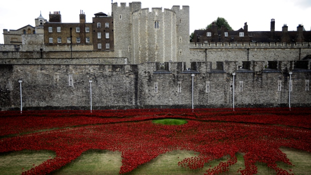 Across Europe, former enemies gathered to commemorate the centenary of the start of the First World War. The war was one of the deadliest conflicts in history, and more than 9 million people were killed.<br><br>Ceramic poppies forming part of an art installation stand laid out in the dry moat of the Tower of London in London, Sunday, Aug. 3, 2014. (AP / Matt Dunham)