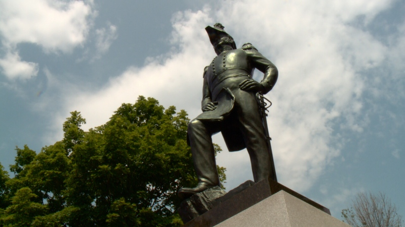 A statue of Colonel John By stands in Ottawa's Majors Hill Park, Aug. 4, 2014