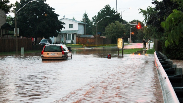 Flooded streets and homes in Burlington, Ont. after the city was drenched with two months worth of rain in just one day. 