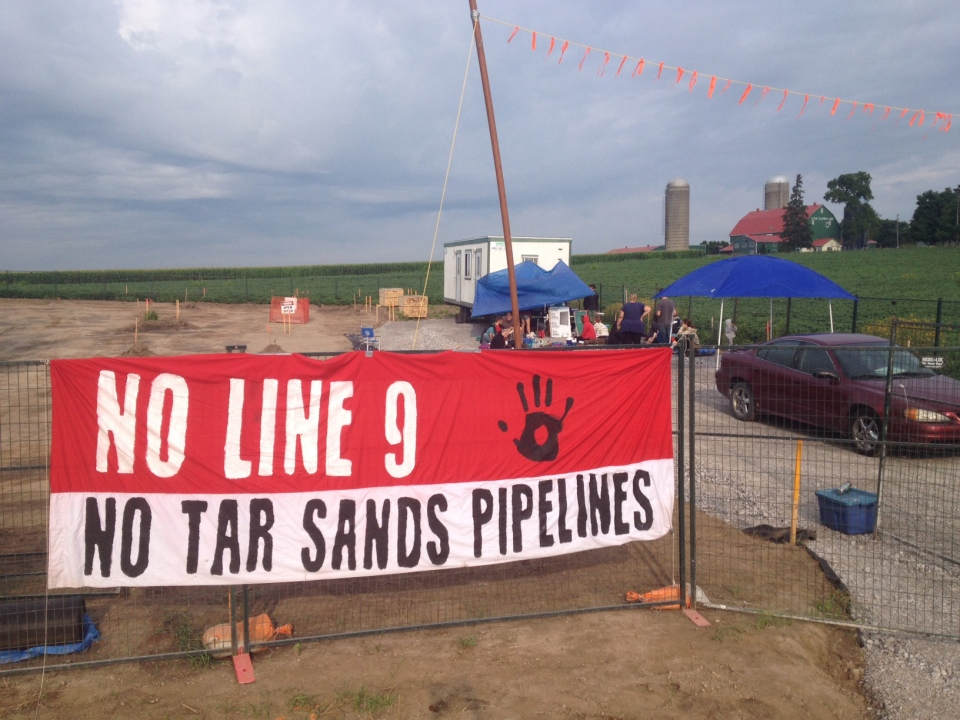 A protest banner hangs outside a work site for Enbridge's Line 9 pipeline near Innerkip, Ont., on Tuesday, Aug. 5, 2014. (Marc Venema / CTV Kitchener)