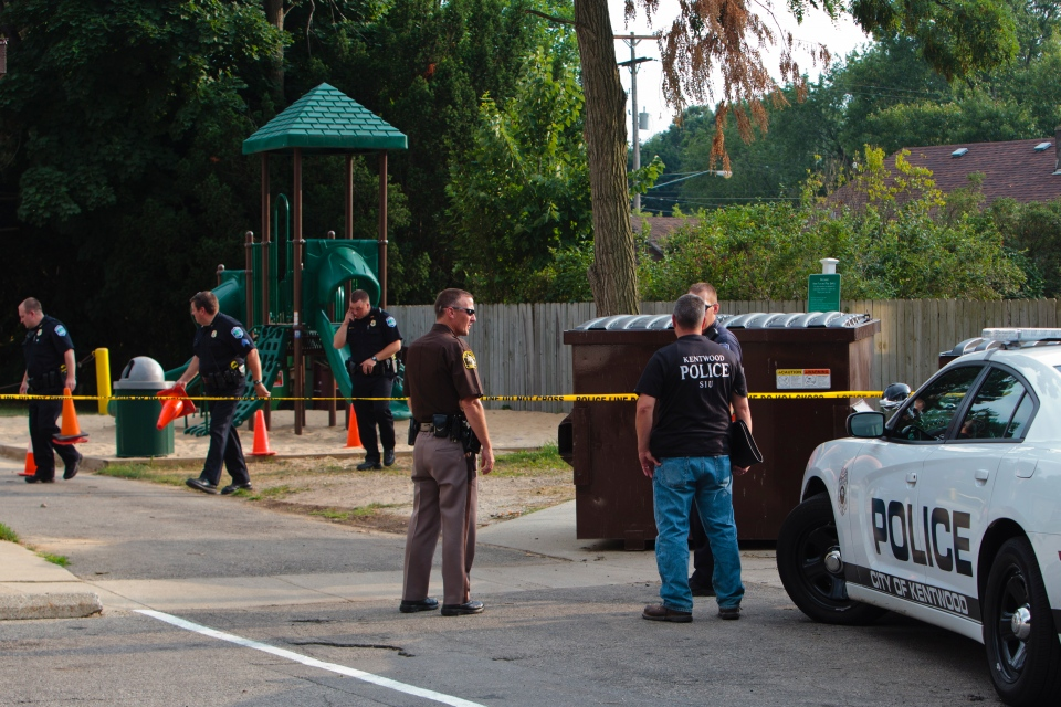 Police investigate a stabbing that occurred in a playground in Kentwood, Mich., on Aug. 4, 2014. (The Grand Rapids Press / Joel Bissell)