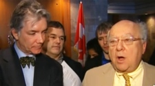 Daniel Turp (left) announced the suit Friday in Montreal with lawyer Julius Grey.