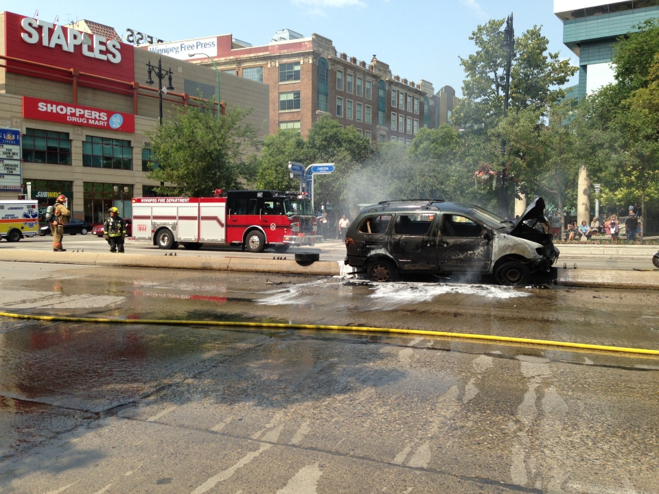 Portage Avenue was briefly closed in both directions Tuesday afternoon as firefighters doused a van on fire on the median near Carleton Street.