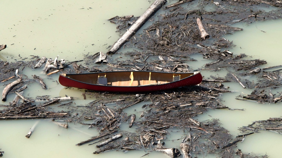 A aerial view shows the damage caused by a tailings pond breach near the town of Likely, B.C., Tuesday, Aug., 5, 2014. (Jonathan Hayward / THE CANADIAN PRESS)