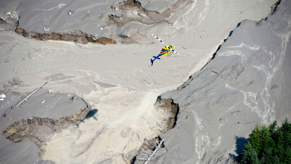A aerial view shows a canoe among the damage caused by a tailings pond breach near the town of Likely, B.C. Tuesday, August, 5, 2014. (Jonathan Hayward / THE CANADIAN PRESS)
