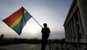 Corbin Aoyagi, a supporter of gay marriage, waves a rainbow flag during a rally at the Utah State Capitol in Salt Lake City in this Jan. 28, 2014 file photo. (AP / Rick Bowmer)