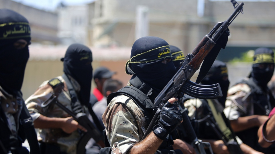Masked militants of the Islamic Jihad group march during the funeral of their comrade Shaaban Al-Dahdouh, whose body was found under the rubble Tuesday, in Gaza City on Wednesday, Aug. 6, 2014. (AP / Hatem Moussa)