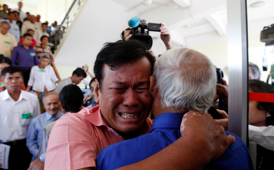 Cambodian former Khmer Rouge survivors, Soum Rithy, left, and Chum Mey, right, embrace each other after the verdicts were announced at the UN-backed war crimes tribunal in Phnom Penh, Cambodia, Thursday, Aug. 7, 2014. (AP / Heng Sinith)