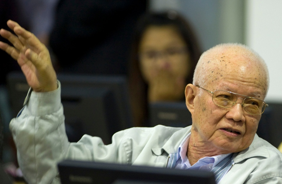 In this photo released by the Extraordinary Chambers in the Courts of Cambodia, Khieu Samphan, the Khmer Rouge's former head of state, gestures as he sits in the courtroom of a UN-backed war crimes tribunal in Phnom Penh, Cambodia on Thursday, Aug. 7, 2014. (Handout / Extraordinary Chambers in the Courts of Cambodia / Mark Peters)