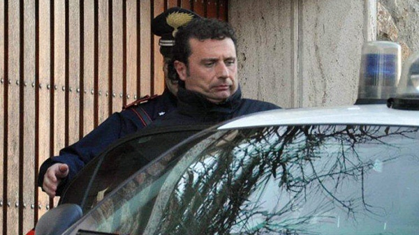 In this photo taken on Saturday, Jan. 14, 2012, Francesco Schettino the captain of the luxury cruiser Costa Concordia, which ran aground off Italy's Tuscan coast, enters a Carabinieri car in Porto Santo Stefano, Italy. (AP / Enzo Russo)