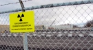 This Nov. 1, 2013 photo shows rows of chambers holding intermediate-level radioactive waste in shallow pits at the Bruce Power nuclear complex near Kincardine, Ontario.  (AP /John Flesher)