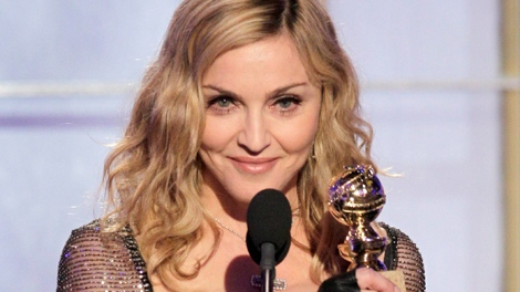 Madonna accepts the award for Best Original Song in a Motion Picture for 'Masterpiece' from 'W.E.' during the 69th Annual Golden Globe Awards on Sunday, Jan. 15, 2012 in Los Angeles (Paul Drinkwater)