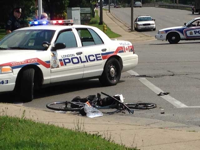 Police are investigating after a crash involving a cyclist and a cement truck in London, Ont. on Thursday, Aug. 7, 2014. (Wayne Jennings / CTV London)