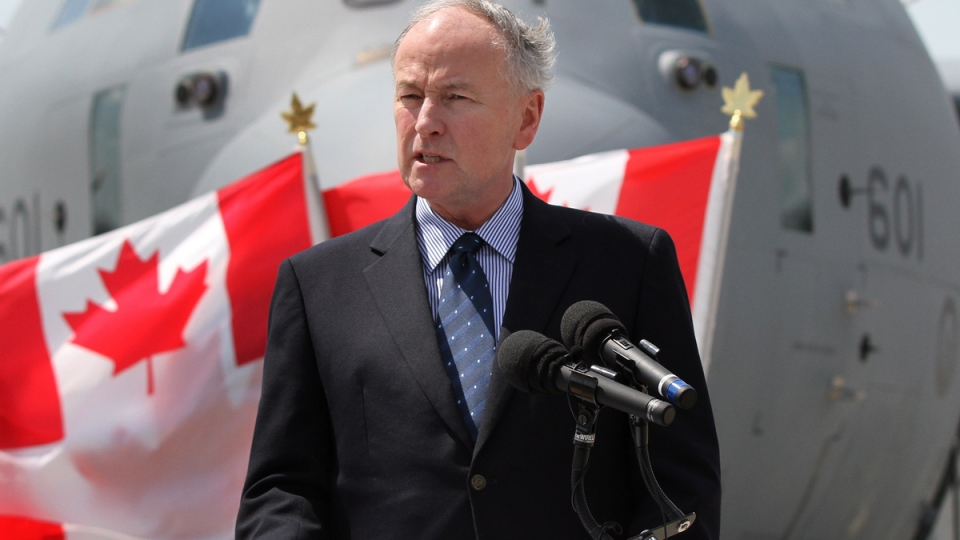 Rob Nicholson, minister of National Defence, speaks on the tarmac at CFB Trenton in Trenton, Ont., on Thursday, Aug, 7, 2014. (Lars Hagberg / THE CANADIAN PRESS)