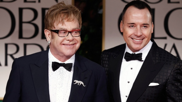 Elton John and David Furnish arrive at the 69th Annual Golden Globe Awards Sunday, Jan. 15, 2012, in Los Angeles. (AP / Matt Sayles)