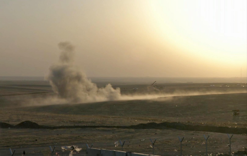 This image made from AP video shows smoke rising from airstrikes targeting Islamic State militants near the Khazer checkpoint outside of the city of Irbil in northern Iraq, Friday, Aug. 8, 2014.  (AP)