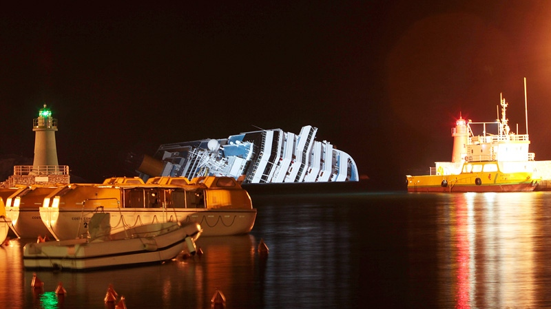 The cruise ship Costa Concordia leans on its side after running aground near the tiny Tuscan island of Giglio, Italy, Monday, Jan. 16, 2012. (AP / Gregorio Borgia)
