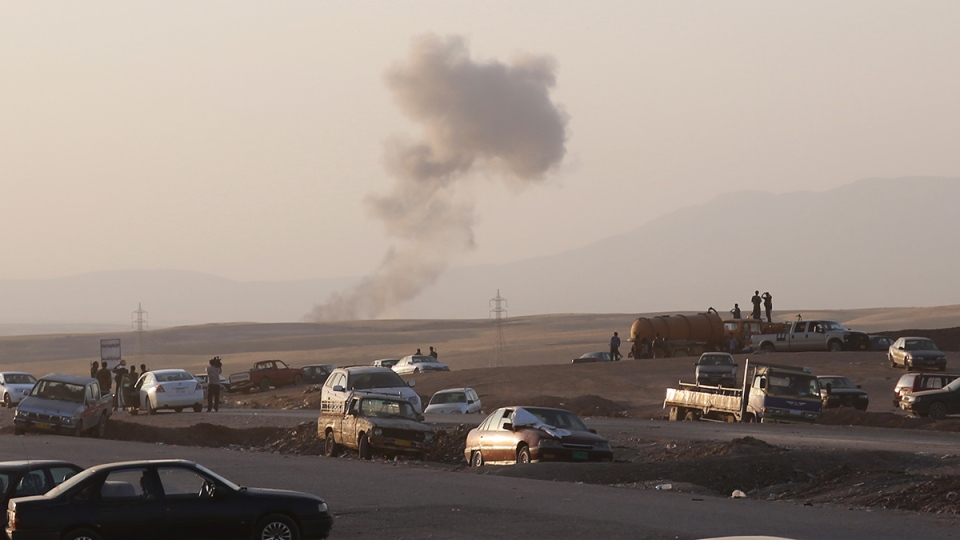 Smoke rises after airstrikes targeting Islamic State militants near the Khazer checkpoint outside of the city of Irbil in northern Iraq, Friday, Aug. 8, 2014. (AP / Khalid Mohammed)