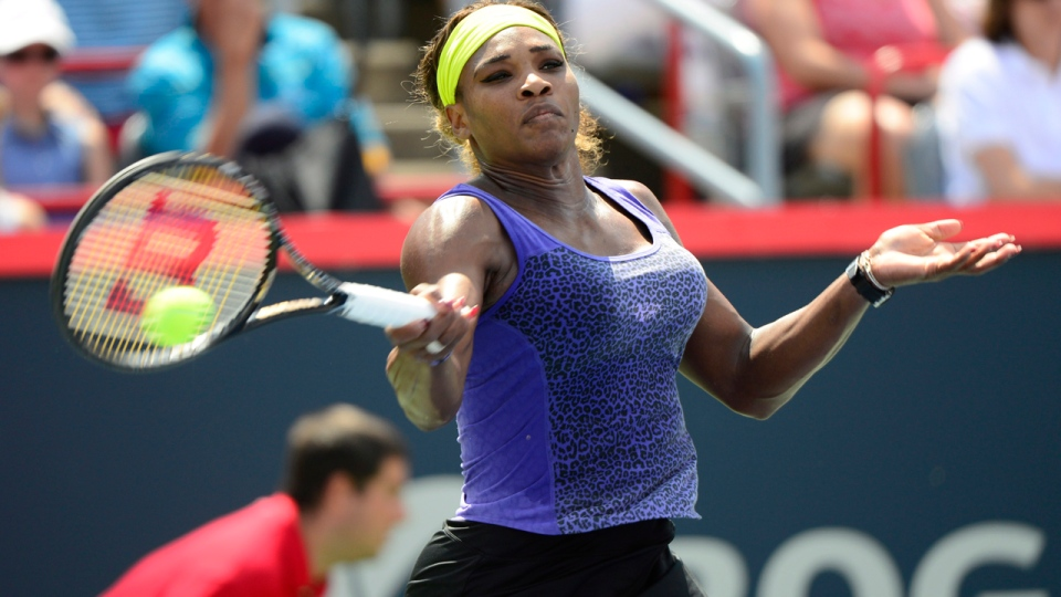 Serena Williams, of the United States, returns to Caroline Wozniacki, of Denmark, during action at the Rogers Cup tennis tournament Friday August 8, 2014 in Montreal. Williams won the match in three sets. THE CANADIAN PRESS/Paul Chiasson