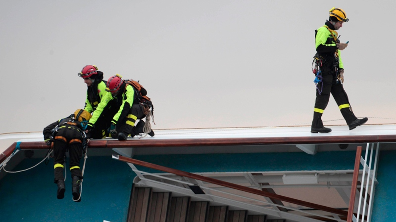 Italian rescue personnel work aboard the Costa Concordia cruise liner, two days after it ran aground off the tiny Tuscan island of Giglio, Italy, Monday, Jan. 16, 2012. (AP / Gregorio Borgia)