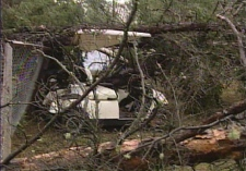 Debris covers a golf cart in Spruce Home, Sask., after a suspected tornado hit the region on Tuesday, Aug. 26, 2008,.