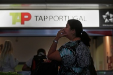 A woman queues at the Portuguese airline TAP customer service desk at Lisbon's Portela international airport, on Saturday, Aug. 9, 2014.  (AP /Francisco Seco)