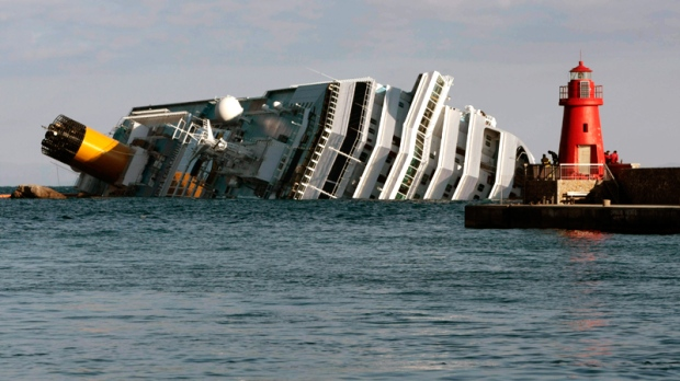 The cruise ship Costa Concordia leans on its side Tuesday, Jan. 17, 2012, after running aground on the tiny Tuscan island of Giglio, Italy. (AP / Gregorio Borgia)