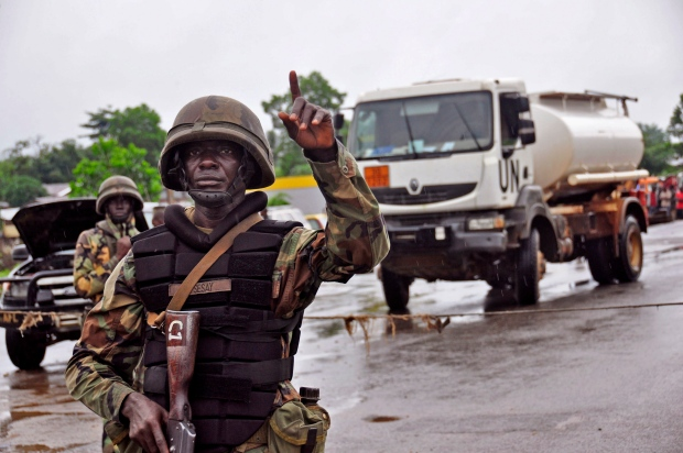 Liberian soldier at Ebola security checkpoint