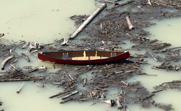 An aerial view shows a canoe among the damage caused by a tailings pond breach near the town of Likely, B.C. Tuesday, August, 5, 2014. (Jonathan Hayward / THE CANADIAN PRESS)