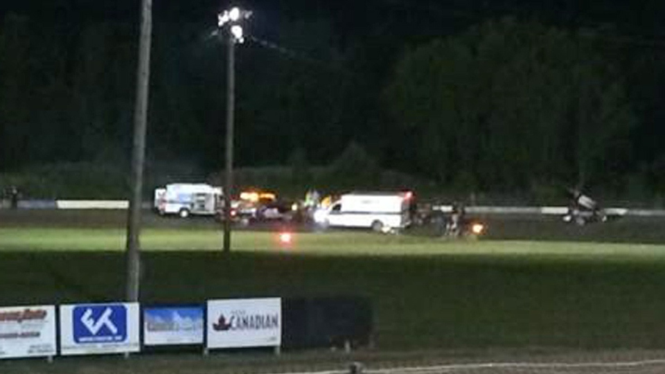 This image provided by Logan Messerly shows ambulances on the scene at Canandaigua Motorsports Park on Saturday Aug. 9, 2014 in Canandaigua, N.Y. (AP / Logan Messerly)