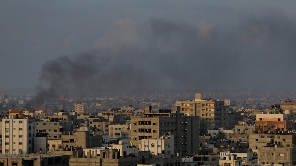 Smoke from a fire caused by an Israeli strike rises over Gaza City, on Sunday, Aug. 10, 2014. (AP / Lefteris Pitarakis)