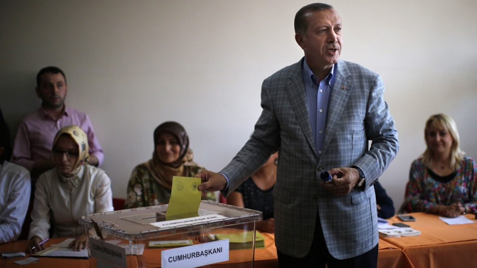 Prime Minister Recep Tayyip Erdogan casts his vote at a polling station in Istanbul, Turkey, on Sunday, Aug. 10, 2014. (AP / Emilio Morenatti)