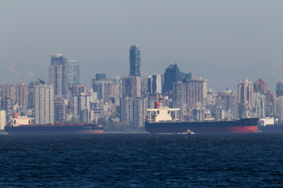 The Vancouver skyline and large freighters are seen through the heat rising off the water of English Bay, B.C. on Monday, May 14, 2012. (Johnathan Hayward/THE CANADIAN PRESS)