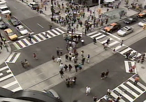 Pedestrians enjoy their first zig-zag across the Yonge and Dundas intersection.