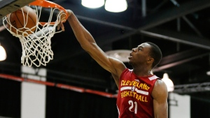 In this July 11, 2014 photo, Cleveland Cavaliers' Andrew Wiggins dunks against the Milwaukee Bucks. (AP / John Locher)