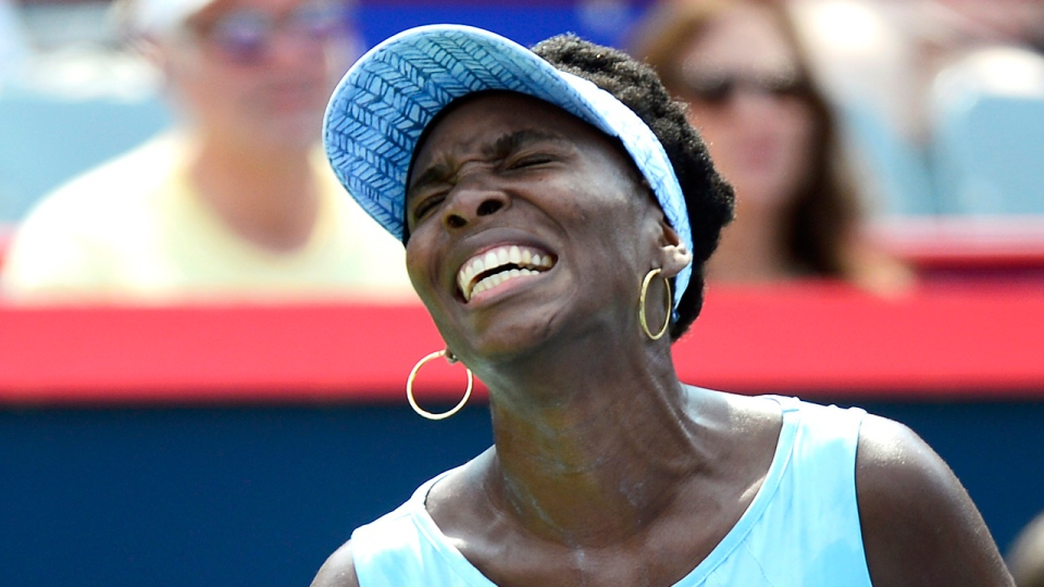 Venus Williams of the United States reacts during her final match against Agnieszka Radwanska of Poland at the Rogers Cup tennis tournament on Sunday August 10, 2014 in Montreal. THE CANADIAN PRESS/Paul Chiasson